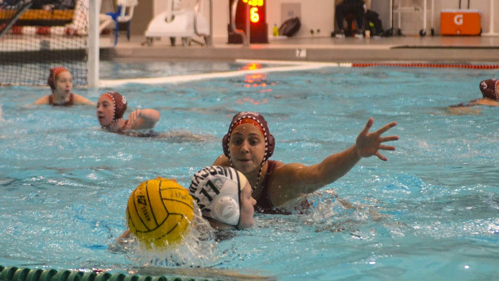 Freshman Taryn Zweifel tries to block Mercyhurst University sophomore Alexa Anderberg from passing the ball March 7 in the Counsilman-Billingsley Aquatics Center. IU defeated Mercyhurst 15-5.