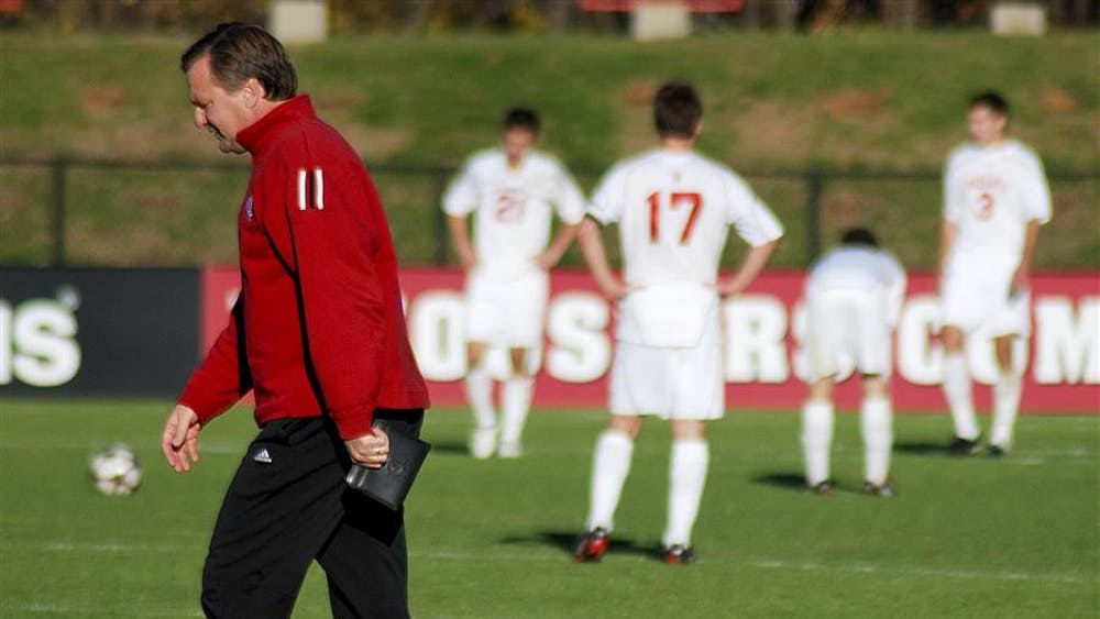 Men's soccer head coach Mike Freitag walks off the field after an IU's loss to Ohio State  at Bill Armstrong Stadium.