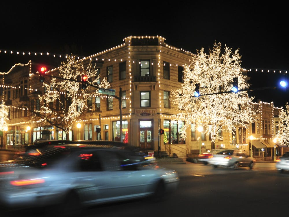 Cars drive under the Canopy of Lights in downtown Bloomington.