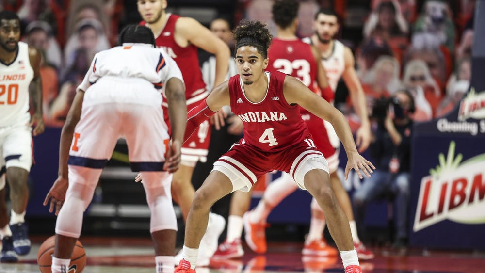 Freshman guard Khristian Lander guards his opponent Dec. 26 at the State Farm Center in Champaign, Illinois against Illinois. IU will play Maryland at Assembly Hall at 8 p.m. on Monday.