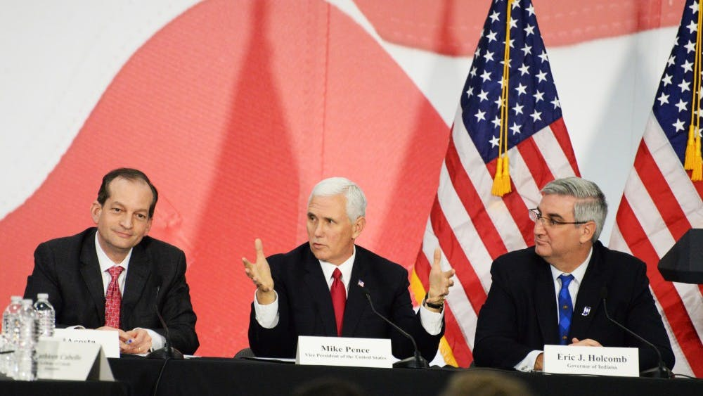 Vice President Mike Pence talks about tax reform during a roundtable discussion with Gov. Eric Holcomb, Sen. Todd Young, R-Indiana, and Secretary of Labor Alexander Acosta. The roundtable took place Thursday at TKO Graphix, a printing company in Plainfield, Indiana.