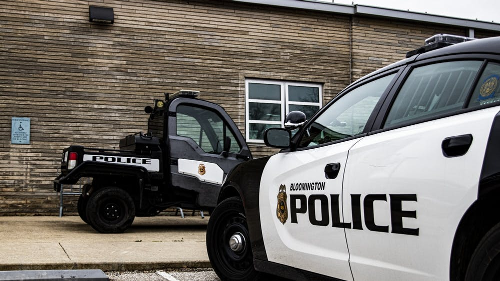 Bloomington Police Department vehicles sit parked March, 12 at the Bloomington Police Department. The department has recently hired two people to work as neighborhood resource specialists.