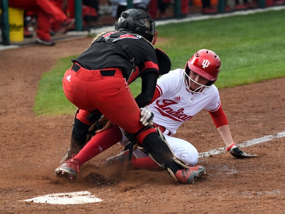 Then-freshman outfielder Taylor Lambert gets tagged out at the plate April 18, 2018. IU softball went 3-3 for the weekend, losing three games to Northwestern and winning three games against Rutgers, in Leesburg, Florida.