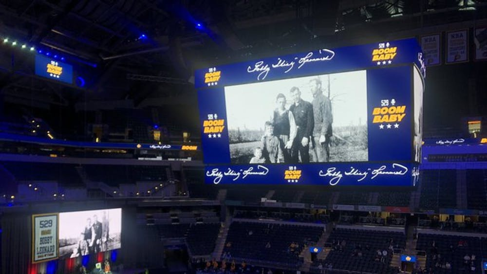 "Pictures of Bobby ""Slick"" Leonard are shown at an event Wednesday honoring Leonard at Bankers Life Fieldhouse in Indianapolis. Leonard played basketball at IU from 1951-54, winning the 1953 NCAA Championship."