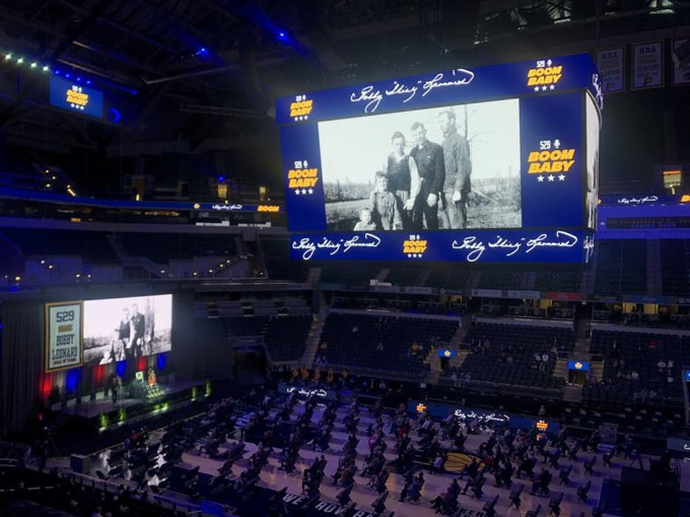 """Pictures of Bobby """"Slick"""" Leonard are shown at an event Wednesday honoring Leonard at Bankers Life Fieldhouse in Indianapolis. Leonard played basketball at IU from 1951-54, winning the 1953 NCAA Championship."""