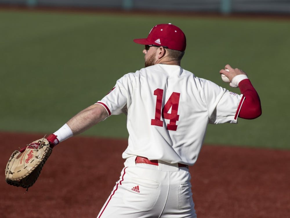 Senior utility Matt Lloyd prepares to throw the ball March 27 at Bart Kaufman Field. IU won two out of three of its games against Penn State this weekend.