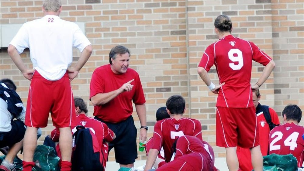 IU men's coach Mike Freitag talks with his team after the No. 12 Hoosiers 3-2 win against New Mexico on Friday, Sept. 11, 2009 in South Bend, Ind. They continue play  in the Mike Berticelli Memorial Tournament on Sunday against Seattle University.