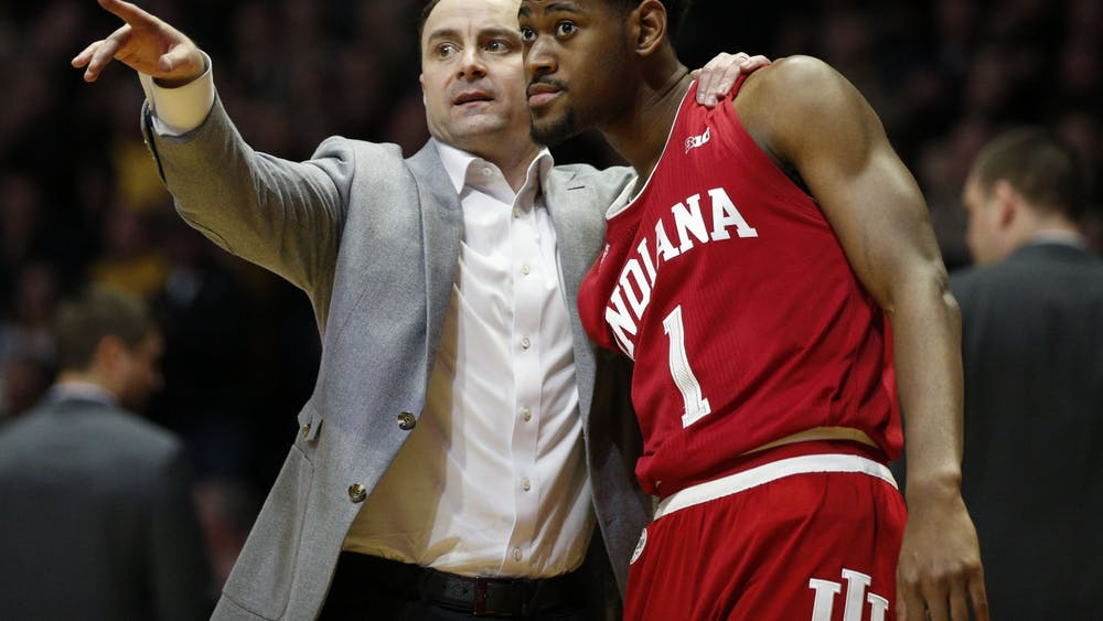 IU men's basketball head coach Archie Miller talks to then-junior guard Al Durham during a free throw Feb. 27 at Mackey Arena in West Lafayette, Indiana. IU will play Florida State University at 7:30 p.m. Wednesday in Tallahassee, Florida, in the Big Ten/ACC Challenge.