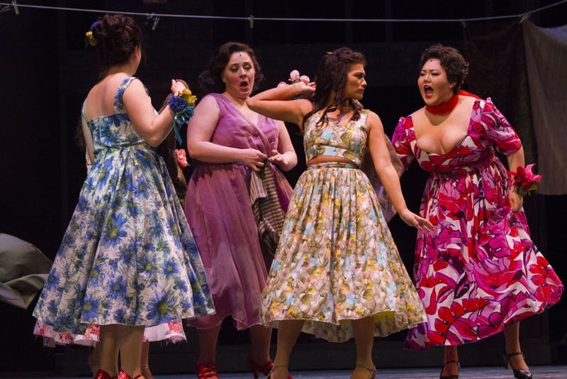 "While singing ""America,"" Anita, played by Hannah Benson, and Rosalia, played by Tiffany Choe, fight over which is better: staying in America or going back to Puerto Rico. West Side Story will play at IU's Musical Arts Center this weekend."