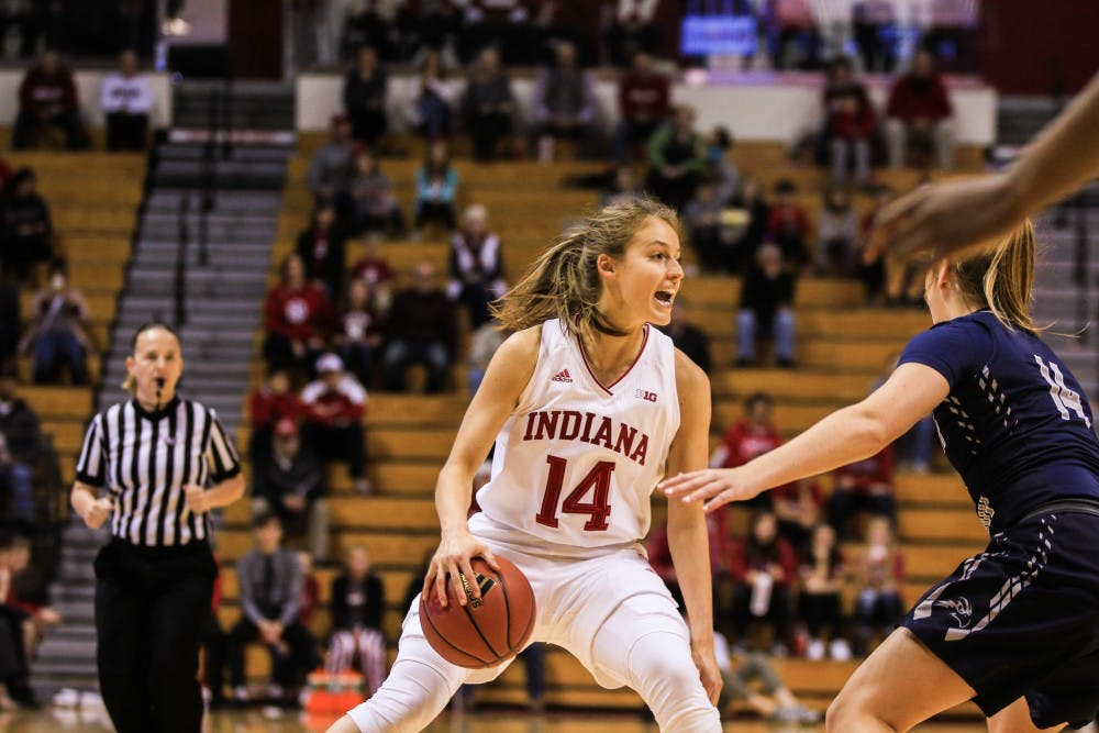 <p>Junior guard Ali Patberg searches for a teammate to throw the ball to. Patberg contributed 30 points to the overall 75 during IU's defeat of University of North Florida, 75-52.&nbsp;</p>