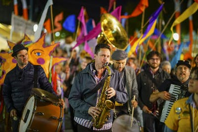 The Raya Brass Band helps leads the Festival Parade during the Lotus World Music and Arts Festival on Sept. 30, 2017, which went from 7th Street and Washington Street to Buskirk-Chumley Theater. Festival attendees were free to join the Brooklyn-based, Balkan brass band with an assortment of colored flags as they marched the streets of Bloomington.