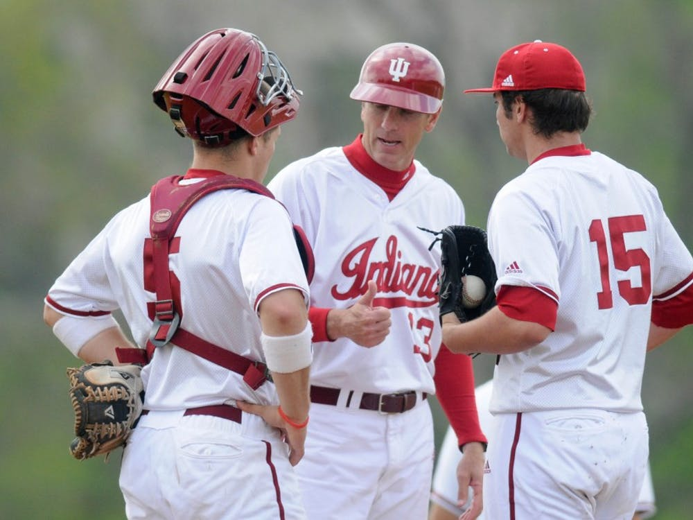 Then-senior catcher Wes Wilson and then-sophomore pitcher Jonny Hoffman talk with head coach Tracy Smith on the mound during IU's 10-3 loss to Miami (Ohio) April 26, 2011 at Sembower Field.
