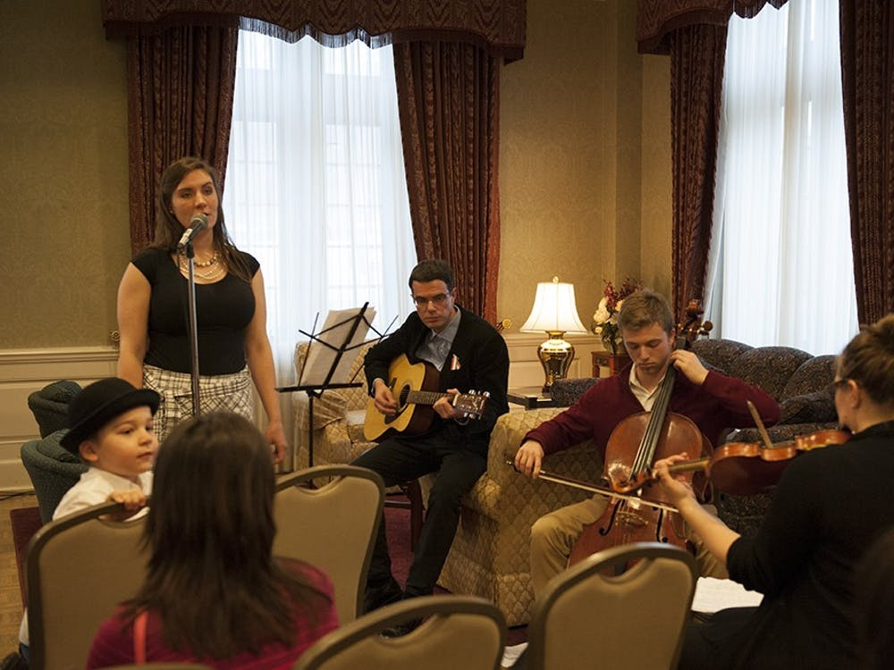 Jessica Storey-Nagy (left in black), Hungarian Cultural Association President, together with the band consisting of Dr. Bence Ságvári, Isaac Bershady, Phil Hanley and Deb Shebish performing traditional Hungarian folk songs to the people present at the Commemoration of the 1848 Hungarian Revolution. The event was held on Tuesday at the University Club President's Room at the IMU.