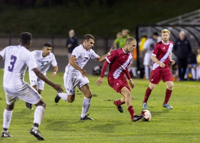 Senior defender Andrew Gutman plays a pass Sept. 26 during IU's game against Northwestern University at Bill Armstrong Stadium. Gutman was temporarily taken out of the game after colliding with one of Northwestern's players.