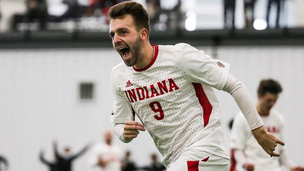<p>Senior Thomas Warr runs on the field during a game against Ohio State on Feb. 22. The Hoosiers defeated Ohio State 3-0.</p>