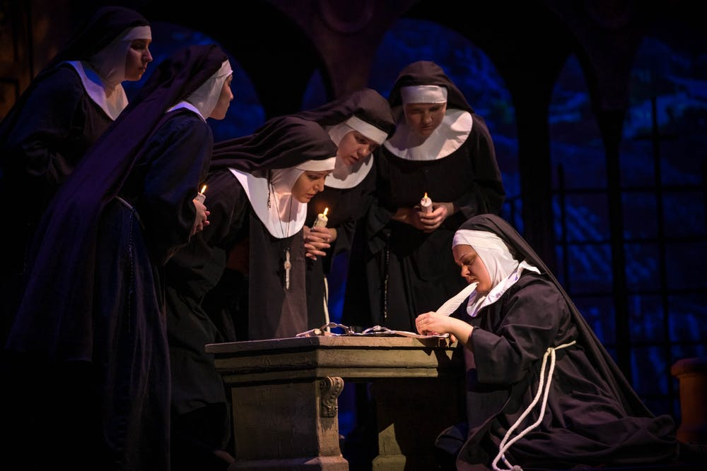 <p>Sister Angelica (Rose-Antoinette Bellino) signs away her claim to her inheritance during a dress rehearsal for &quot;Suor Angelica&quot; on Feb. 4 in the Musical Arts Center. IU Opera and Ballet Theater will perform &quot;Suor Angelica&quot; and &quot;Gianni Schicchi&quot; on Feb. 7-8 and Feb. 14-15 at the Musical Arts Center.</p>