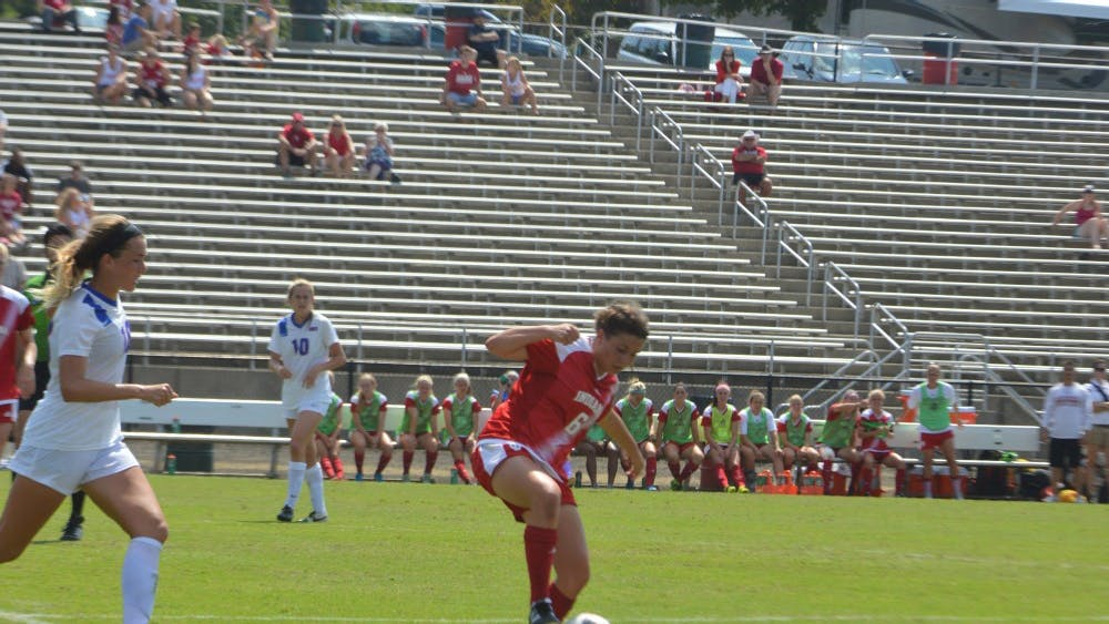 Indiana Univeristy player, Julia De Angelis dribbles the ball  away from a Southern Methodist Universtiy player during the Hoosier game on Monday, Sept. 5 at Bill Armstrong Stadium.