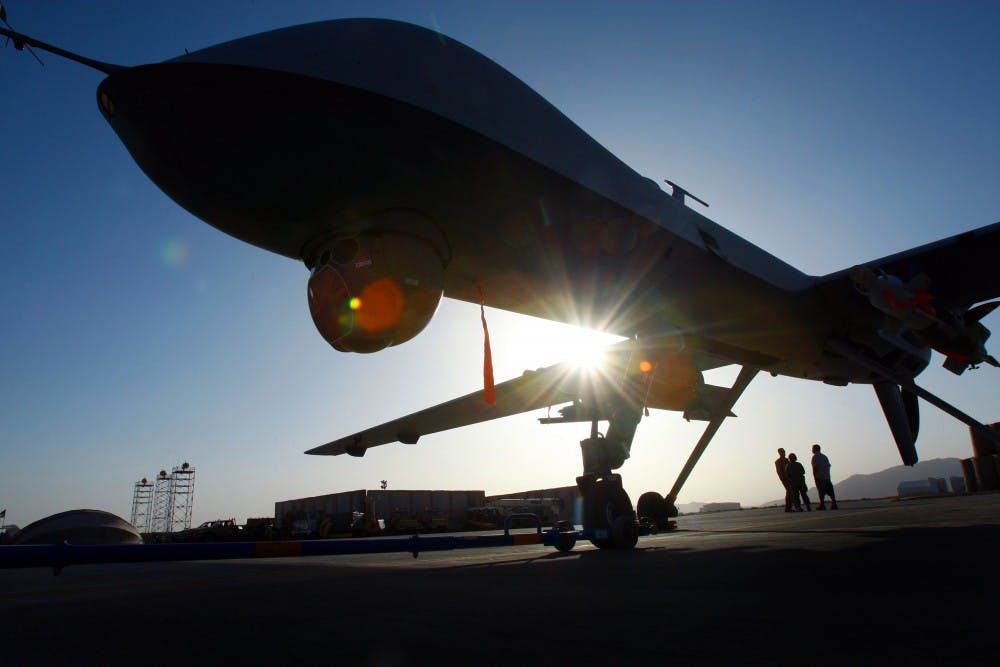 A Predator drone stands in Kandahar, Afghanistan. A growing fleet of U.S. spy planes and drones in Asia, Africa, the Middle East and elsewhere allows U.S. Air Force analysts to gather intelligence without ground combat troops.  TRIBUNE NEWS SERVICE