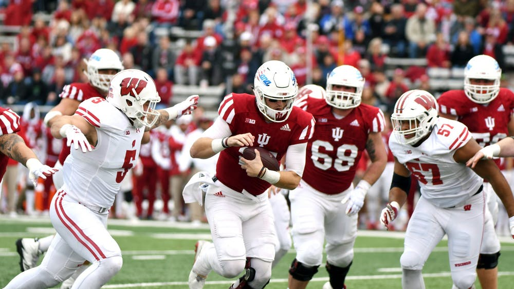Then-redshirt senior quarterback Richard Lagow runs the ball against Wisconsin on Nov. 4, 2017, at Memorial Stadium. IU's football team has improved dramatically since its last matchup with Wisconsin in 2017, when the Hoosiers lost 45-17.