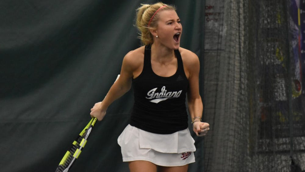 Junior Madison Appel celebrates after hitting the match-winning shot in her 4-6, 6-0, 6-4 win over the University of Cincinnati. IU improved to 3-0 on the season after their 4-2 win over UC on Saturday.