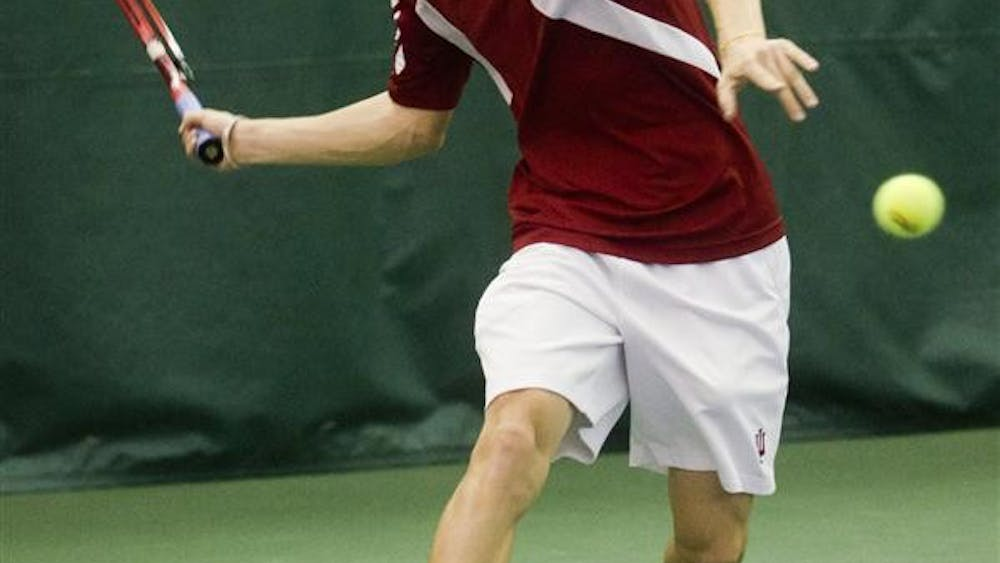 Sophomore Josh MacTaggart prepares to volley the ball during the Hoosier's 2-4 loss to Oklahoma on Feb. 13 at the IU Tennis Center.