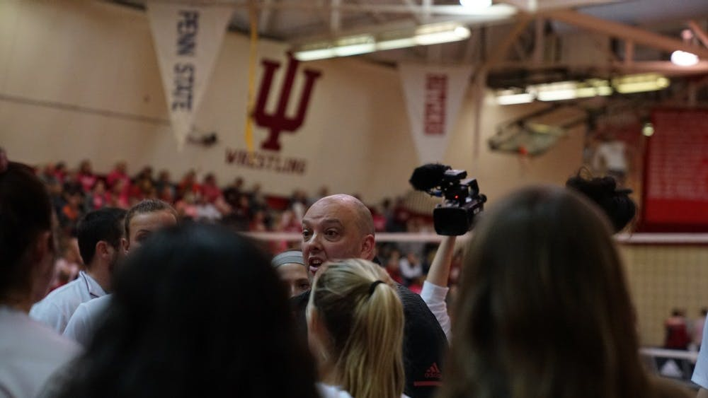 IU volleyball Coach Steve Aird encourages the team to keep up its intensity against Ohio State on Oct. 19 in University Gym. IU finished Aird's first season as head coach with a 7-13 conference record.