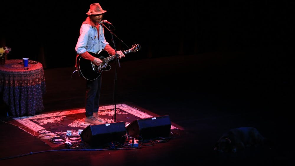 American singer and songwriter Todd Snider performs Feb. 12 at the Buskirk-Chumley Theater. Snider's dog Cowboy Jim laid at the edge of the stage while Snider performed.
