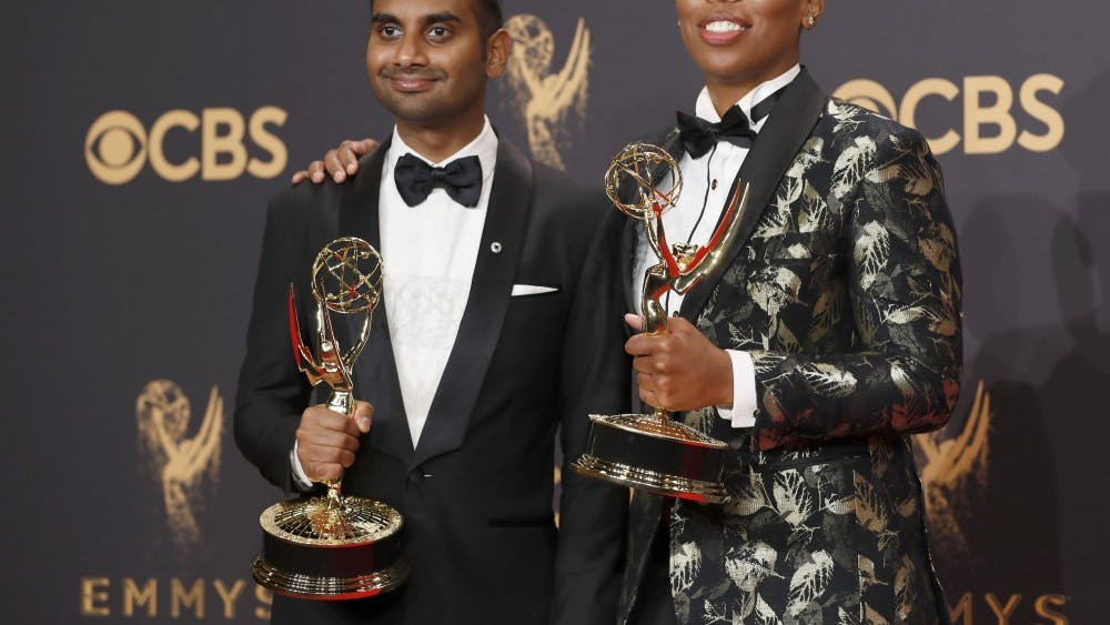 """Aziz Ansari and Lena Waithe pose in the Trophy Room at the 69th Primetime Emmy Awards on Sept. 17. The two worked together on """"Master of None,"""" which won an Emmy for its episode, """"Thanksgiving."""""""