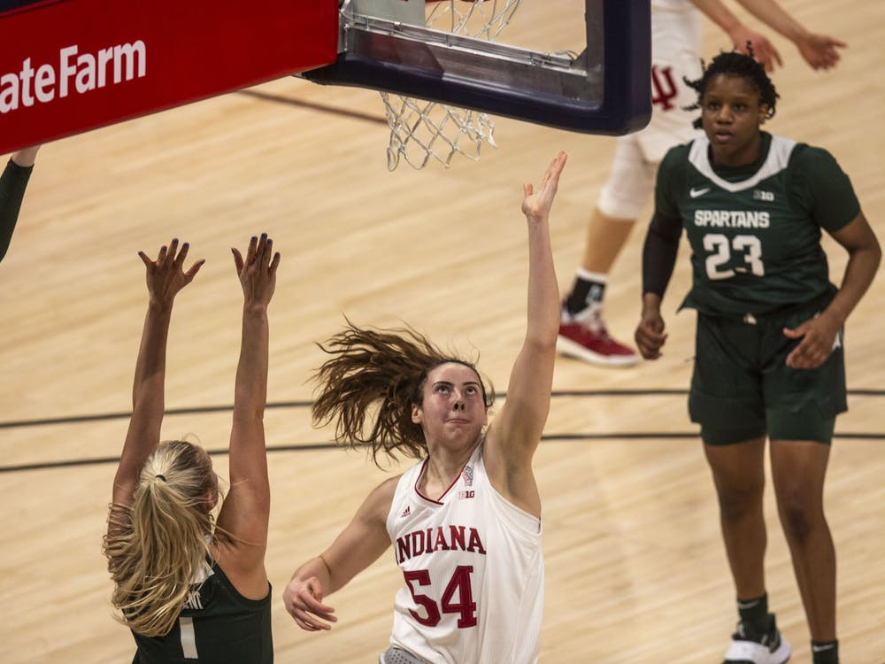 Sophomore forward Mackenzie Holmes attempts a layup March 11 in the quarterfinals of the Big Ten women's basketball tournament at Bankers Life Fieldhouse in Indianapolis. IU advanced to the Sweet 16 for the first time in program history with a 70-48 win over Belmont on Wednesday.
