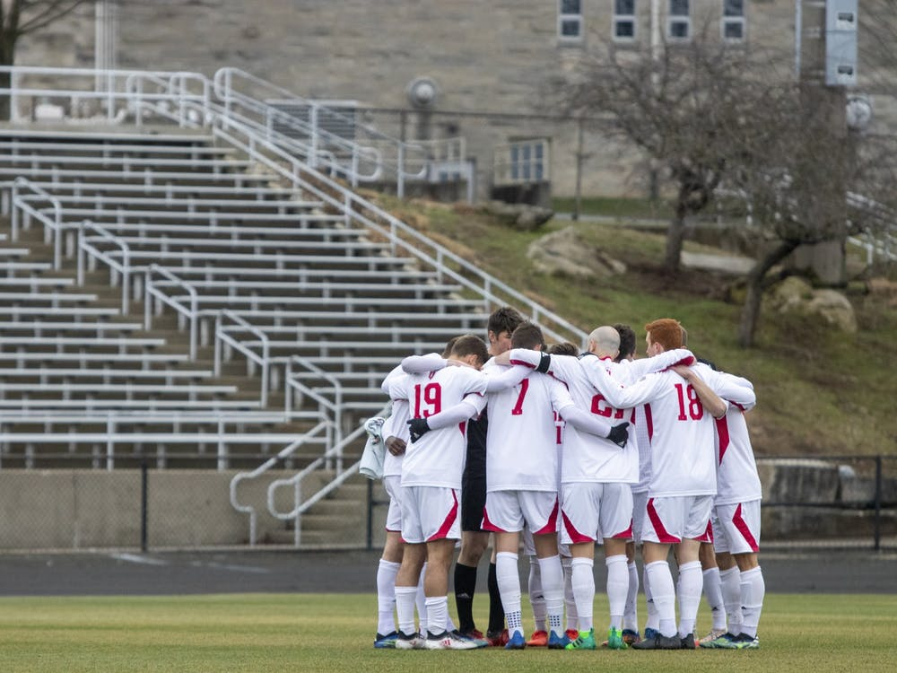 IU men's soccer's starters gather in a huddle March 15 at Bill Armstrong Stadium. IU fell 1-0 to Marshall University in overtime of the NCAA Championship on Monday in Cary, North Carolina.