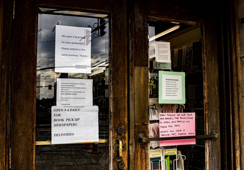 <p>Signs on the front doors inform customers about visiting rules May 12 at the Book Corner. Some retail businesses and restaurants are preparing to reopen at 50% capacity Friday, while others are planning on remaining closed until they are able to reopen closer to full capacity.</p>