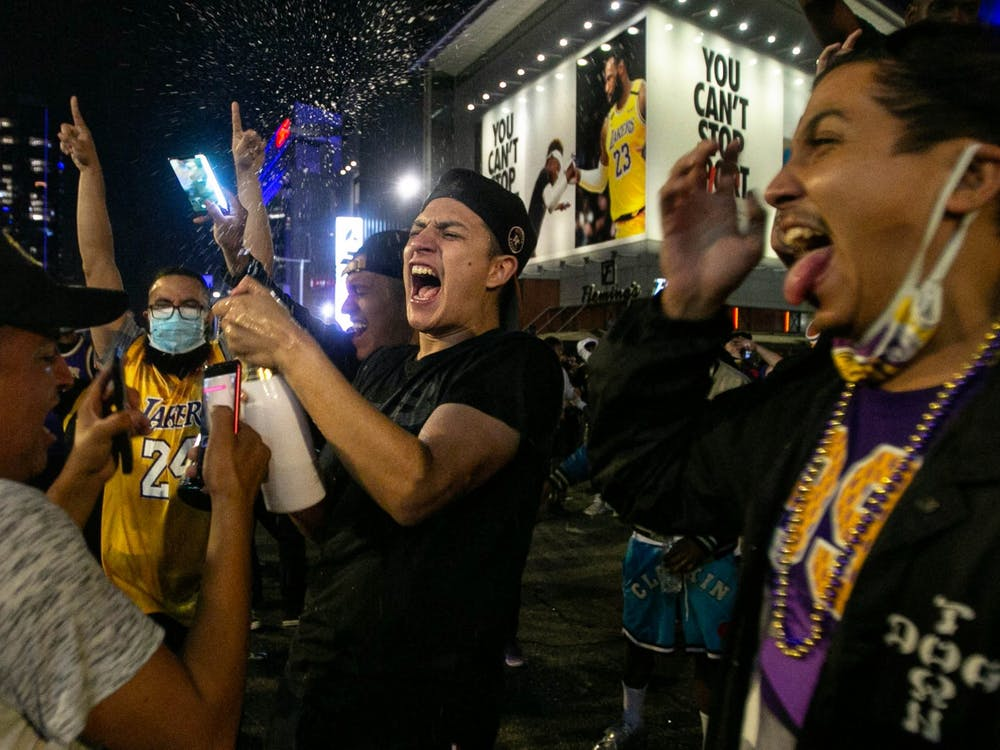 A Los Angeles Lakers fan celebrates by spraying a bottle of champagne near the Staples Center after the Lakers' 106-93 Game 6 win over the Miami Heat on Oct. 11 in Los Angeles.