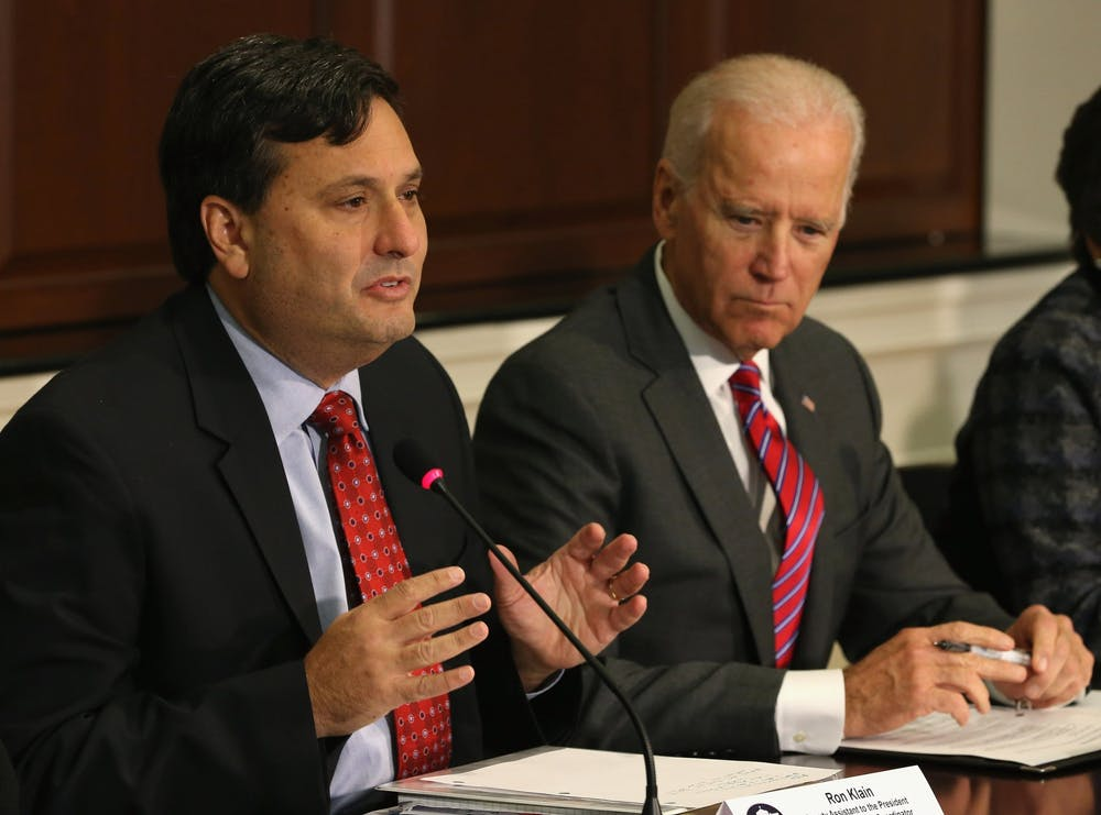 <p>Ron Klain, left, with then-Vice President Joe Biden, speaks during a 2014 meeting at the Eisenhower Executive office building in Washington, D.C. Klain was named chief of staff Wednesday to Biden&#x27;s cabinet.</p>