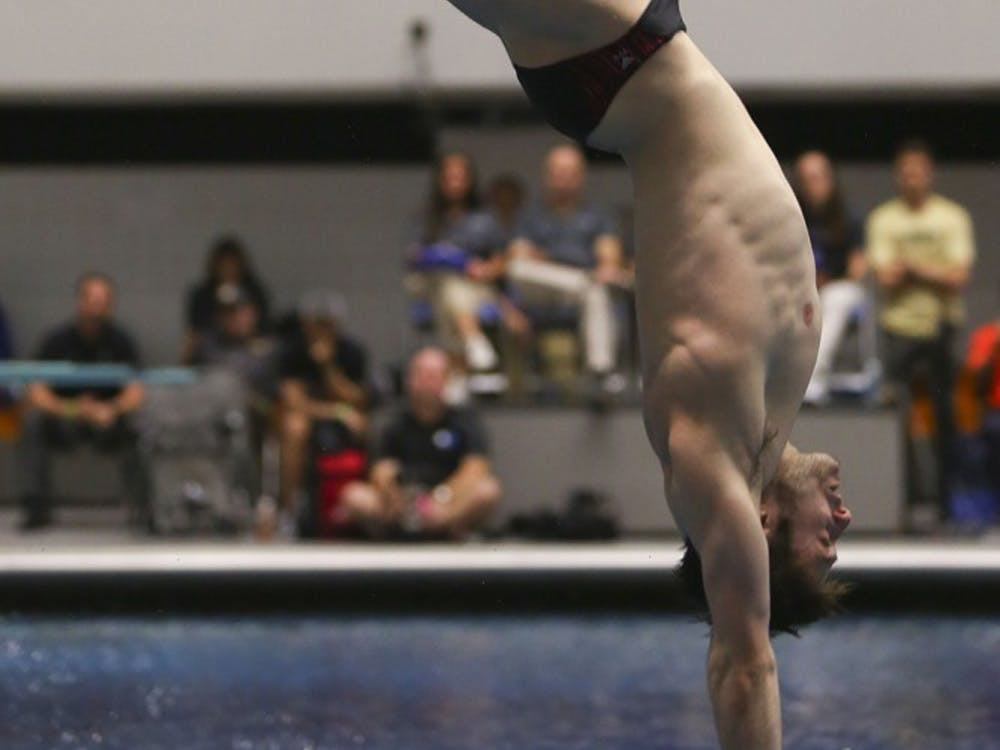 Junior Michael Hixon performs a back 2.5 somersault pike at the IUPUI natatorium on Friday, March 24, 2017 at the NCAA Swimming and Diving Championships. Hixon placed 5th in the men's 1-meter dive and 6th in the 3-meter synchro at the 2017 FINA World Championships in Budapest, Hungary.