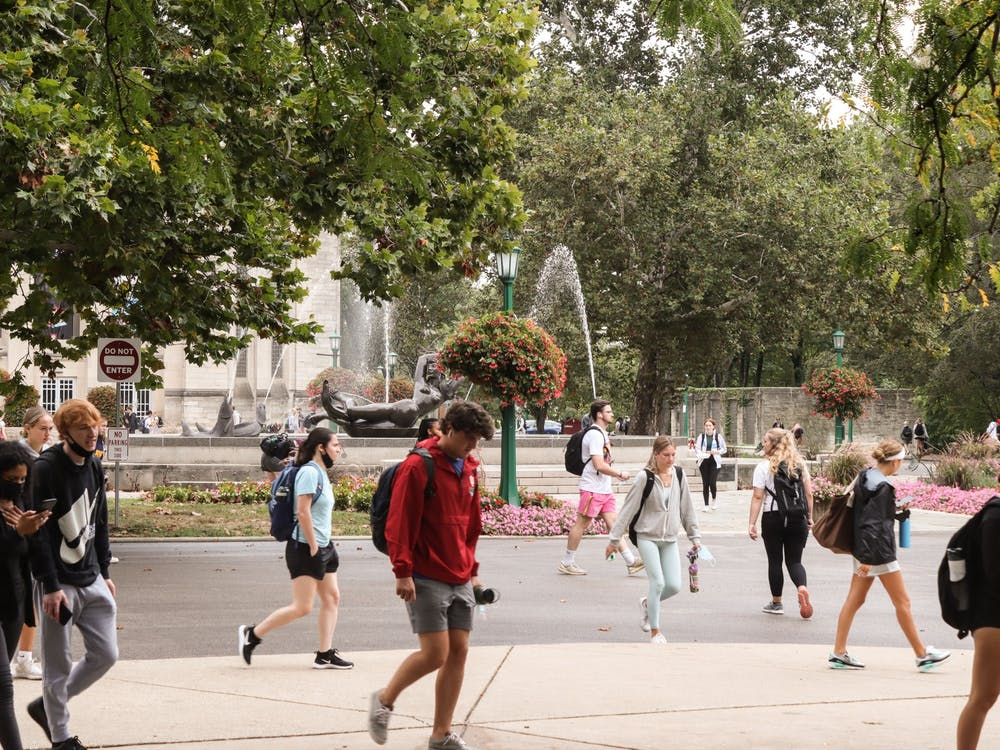 Students walk Aug. 30, 2021, in front of Showalter Fountain.