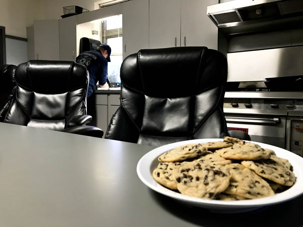 Chocolate chip cookies baked by firefighter Vick Vollrath sit out on the kitchen table at headquarters. Vollrath said he likes to bring in homemade treats to make the crew feel more at home.