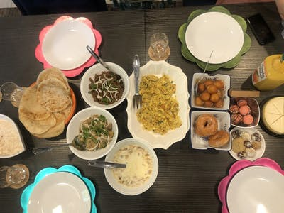 An Eid meal is presented on a table in senior Manha Iftikhar's home in Newburgh, Indiana. Muslims celebrate Eid al-Fitr to mark the end of Ramadan.