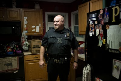 Paul Post stands in the kitchen of his home Nov. 21. Post has to arrive to the station by 5:30 a.m. for roll call at the Bloomington Police Station.