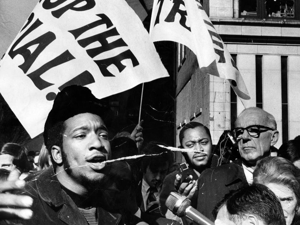 """Black Panther Party deputy chairman Fred Hamptom rallies with others outside the Federal Building Oct. 29, 1969. The Rainbow Coalition was founded by Black Panther members Hamptom and Bobby Lee, along with Young Lords founder José """"Cha Cha"""" Jiménez and Young Patriots leader William """"Preacherman"""" Fesperman."""