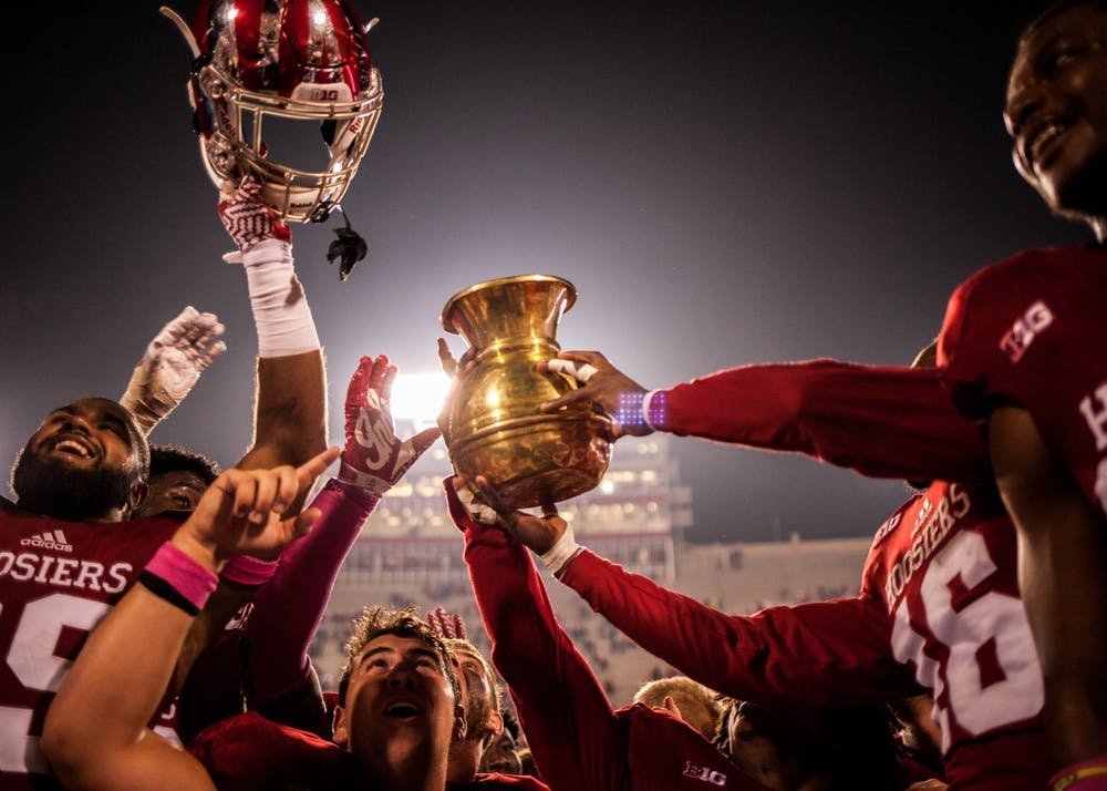 <p>Indiana football players raise the Old Brass Spittoon after defeating Michigan State 24-21 in overtime Oct. 1, 2016, at Memorial Stadium. Indiana will try to keep the trophy at home when it plays No. 10 Michigan State Saturday.</p>