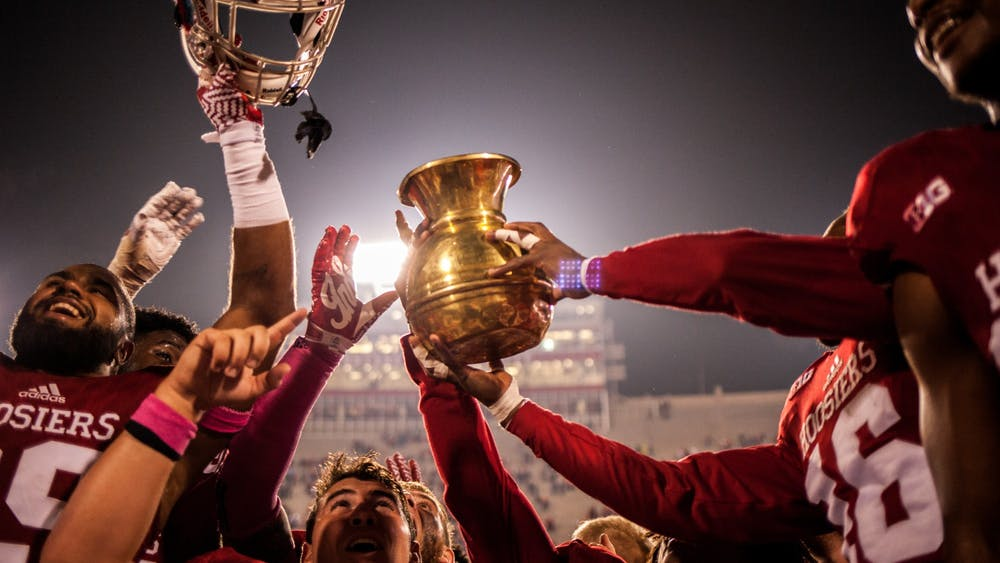 Indiana football players raise the Old Brass Spittoon after defeating Michigan State 24-21 in overtime Oct. 1, 2016, at Memorial Stadium. Indiana will try to keep the trophy at home when it plays No. 10 Michigan State Saturday.