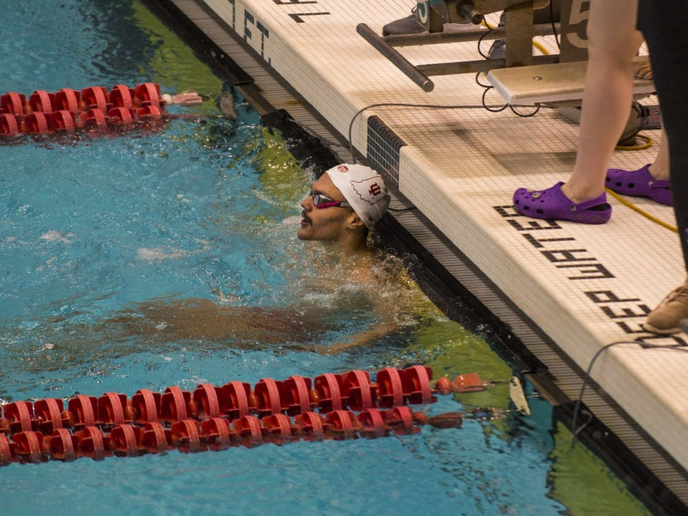 Junior Gabriel Fantoni looks at the scoreboard for his time after finishing the 200-yard backstroke race Jan. 25 in a meet against Purdue at the Counsilman-Billingsley Aquatics Center in Bloomington. IU will compete in the Big Ten Men's Swimming and Diving Championships Wednesday through Saturday.