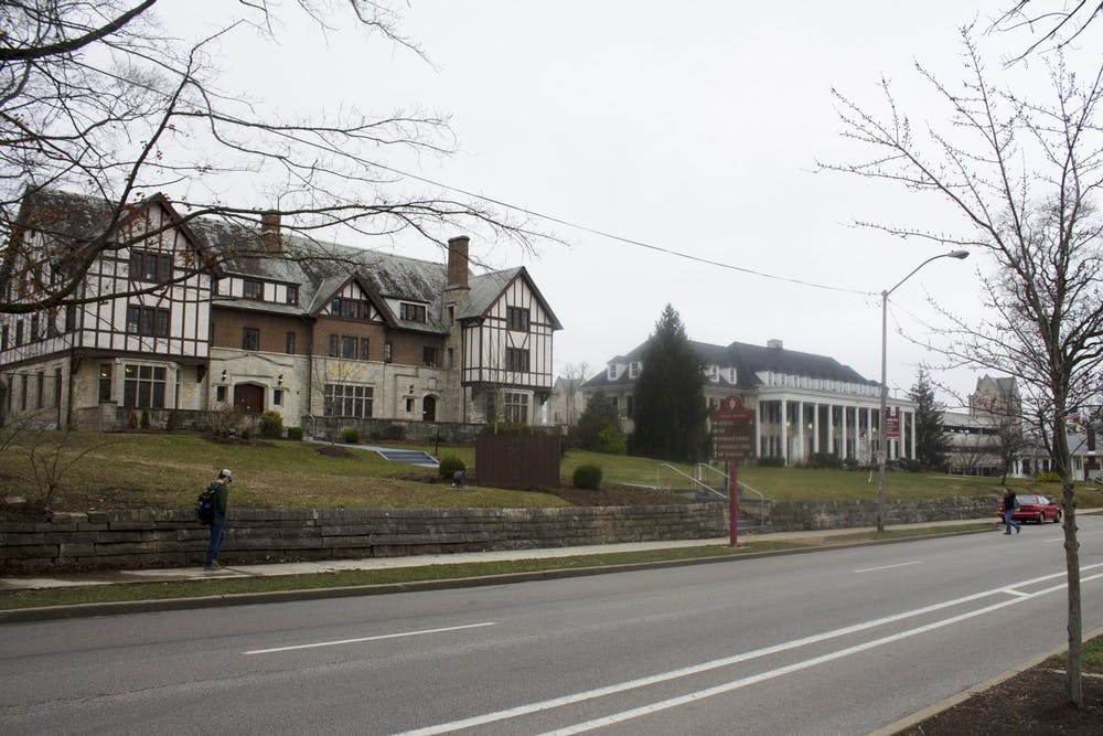 <p>Phi Kappa Tau, left, and Acacia, right, fraternity houses sit next to each on Third Street. Out of the 40 fraternity and sorority houses, 37 of them are completely closed for the rest of the semester, IU spokesperson Chuck Carney said.</p>
