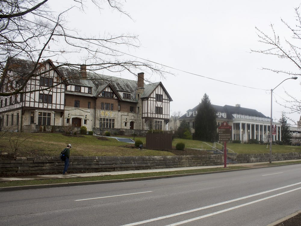 Phi Kappa Tau, left, and Acacia, right, fraternity houses sit next to each on Third Street. Out of the 40 fraternity and sorority houses, 37 of them are completely closed for the rest of the semester, IU spokesperson Chuck Carney said.