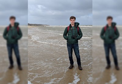 Michael Skiles stands during spring break on Omaha Beach in Normandy, France.
