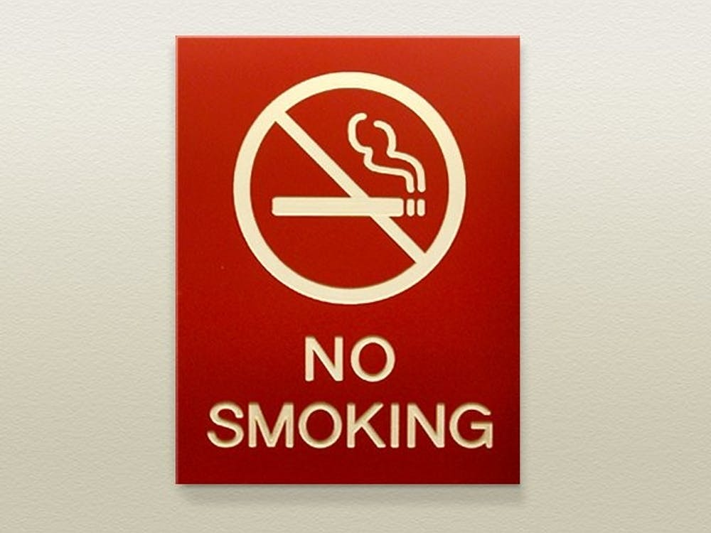 """<p>A """"no smoking"""" sign hangs on the wall.&nbsp;</p>"""