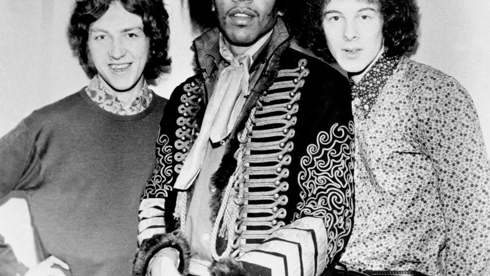 Guitarist and singer, Jimi Hendrix with Mitch Mitchell, left, and Noel Redding, right.
