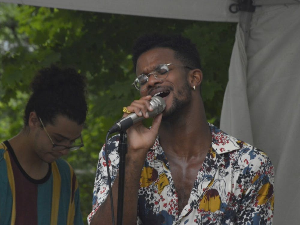 Dexter Clardy sings as Alex Dura plays the keyboard behind him. Their band, Huckleberry Funk, performed Aug. 18 at Oliver Winery.