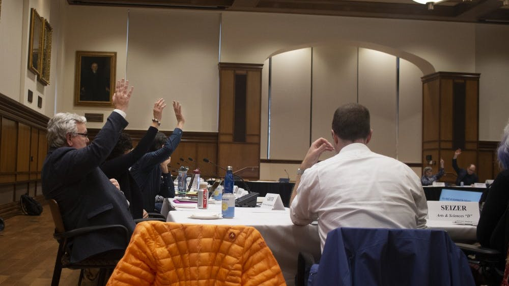 Members of the Bloomington Faculty Council vote Feb. 5 in Presidents Hall in favor of adding political affiliation to the list of backgrounds discussed during bystander intervention training.