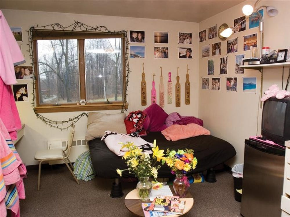 """Pictures and decorations line the walls in a Gamma Phi Beta room.  Sorority members often have double rooms to decorate as they wish, but sleep in """"cold dorms"""" - large spaces that are usually located on the top floor of a house used only for sleeping."""